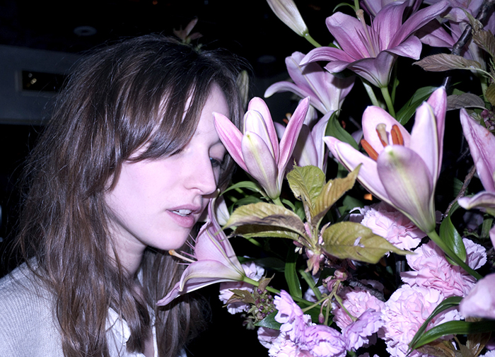 Model, stylist and Purple muse VALENTINE FILLOL CORDIER with flowers, London. Photo Olivier Zahm